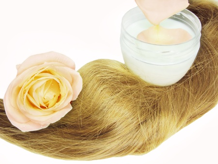 gingery: gingery hair wave bottle of tonic with rose isolated