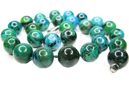 chrysocolla semiprecious blue and green beads isolated on white background photo