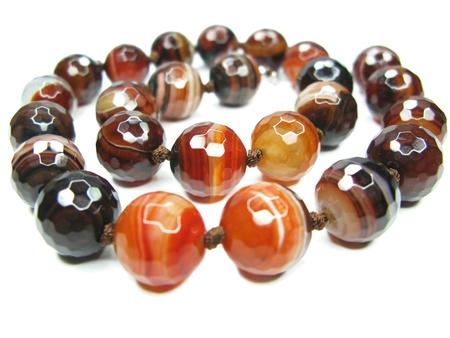 semige, sardonyx beads isolated on white background photo