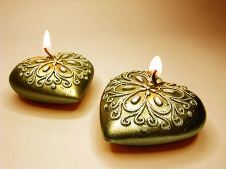 set of heart scented candles as present on yellow background Stock Photo - 12154004