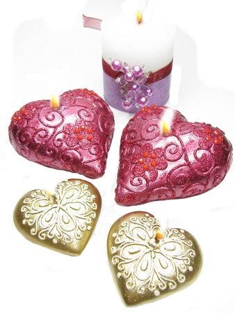 set of heart scented candles as present isolated photo