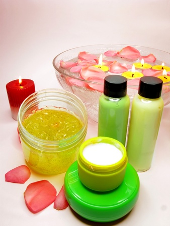 spa hair mask creme liquid soap candles essences and rose photo