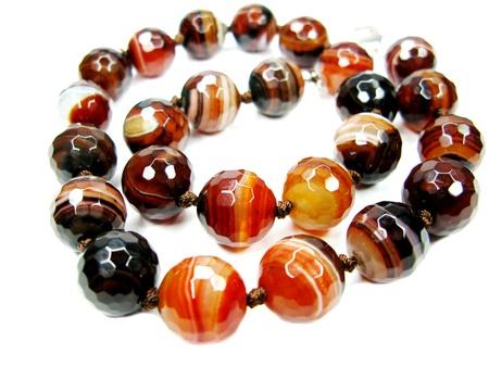 beads: sardonyx semigem beads isolated on white background