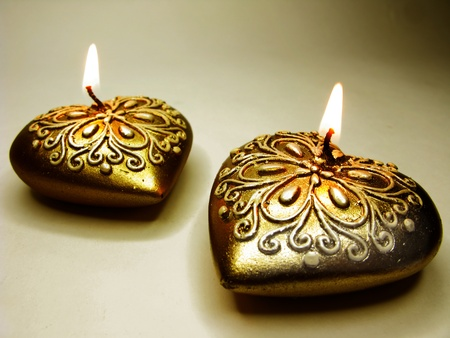 set of heart spa aroma scented candles as present on dark background photo