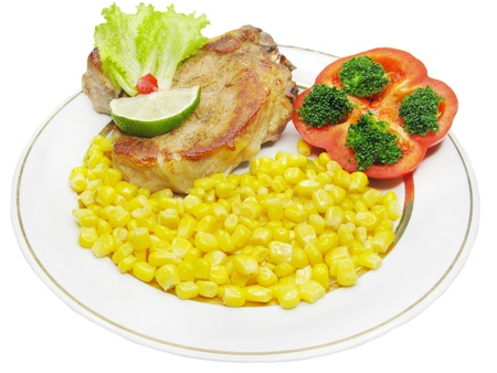 cooked meat with corn and tomato photo