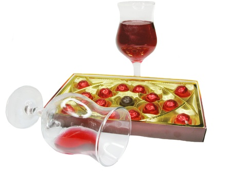 enveloping: red wine in glass goblets and chocolate sweets