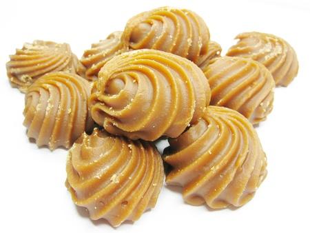 sweetmeats: dairy brown sweetmeats in heap isolated