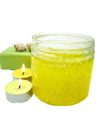 body scrub bottle and soap among candles photo