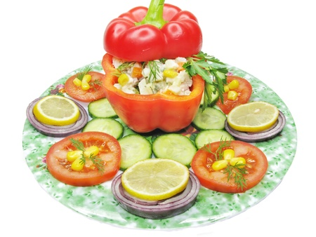 stuffed red pepper with cucumber onion lemon and tomato photo