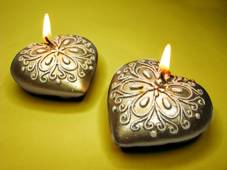 set of heart scented candles as present on dark background photo