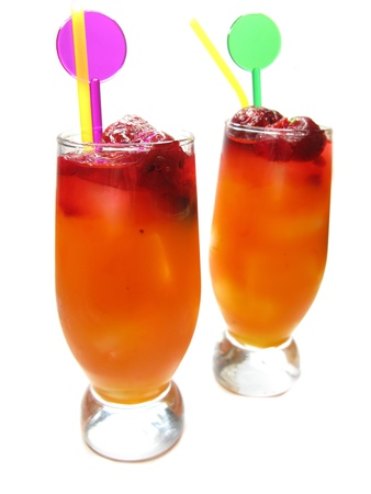 two red fruit punch cocktail drinks with strawberry and ice photo