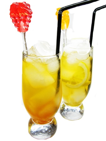 two glasses of fruit juice drinks with ice and mint photo