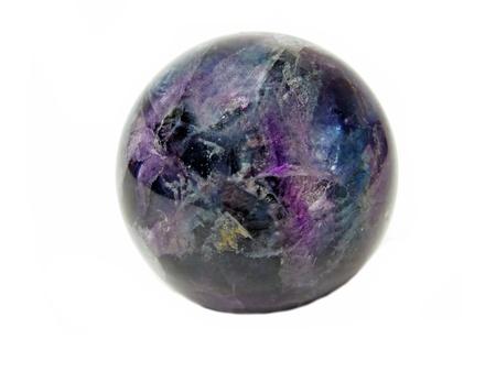 fluorite: round fluorite mineral crystal isolated Stock Photo