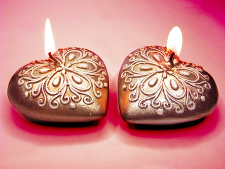 set of heart scented spa aroma candles on dark background photo
