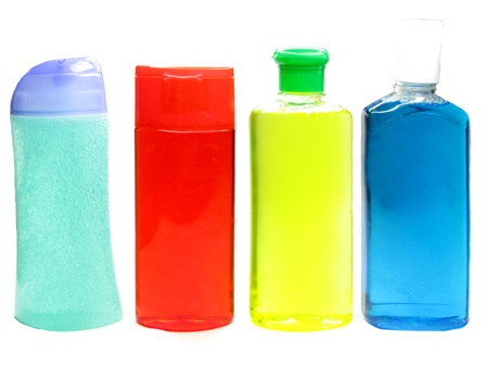 bottles of shampoo and shower gel in different colors photo