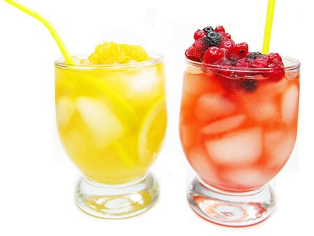 two fruit punch cocktail drinks with strawberry and ice photo