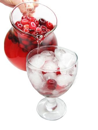 fruit cruchon cocktail punch pouring out of jug into wineglass photo