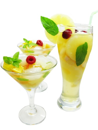 cruchon: group of fruit cruchon cocktails punch with ice and fruit