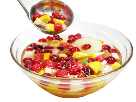 fruit cruchon cocktail punch in bowl with ice and fruit photo