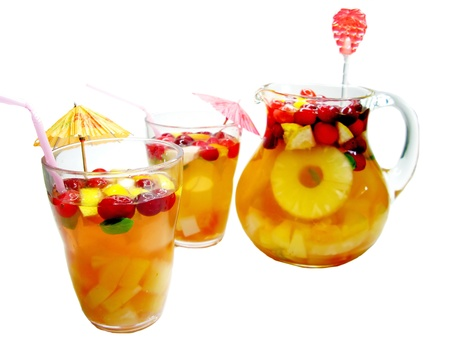 fruit cruchon cocktails punch in jug and glasses with ice and fruit