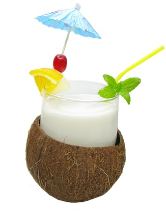 tropical cocktail drink in coconut with mint