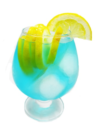 alcoholic blue curacao cocktail with ice and lemon photo