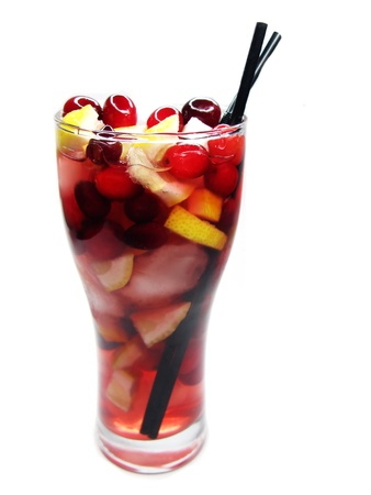 red fruit punch cocktail drink with cherry lemon and ice photo