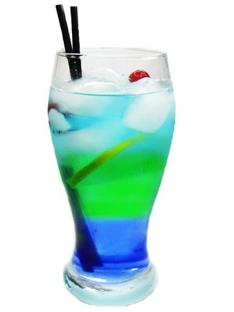 alcoholic blue green curacao cocktail with ice and lemon photo