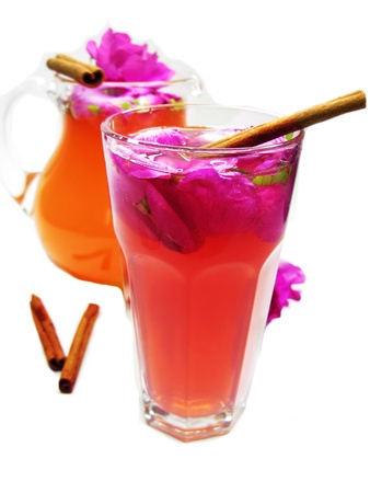 rose punch tea cocktail punch with cinnamon spice sticks photo