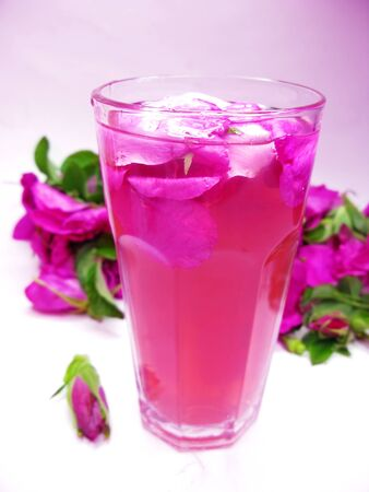 rose punch tea cocktail punch with flowers on background  photo