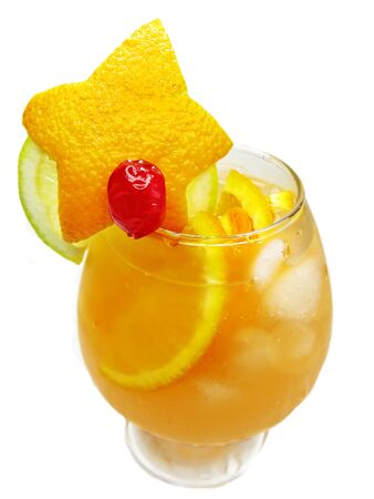 yellow fruit punch cocktail drink with cherry lemon and ice photo