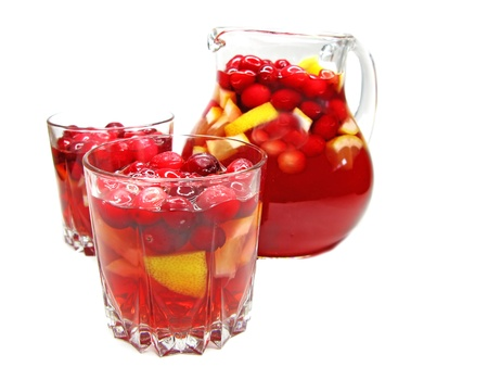 cruchon: fruit cruchon cocktail punch in jug and glasses with ice and fruit
