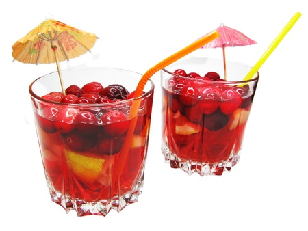 red fruit punch cocktail drinks with cherry lemon and ice photo