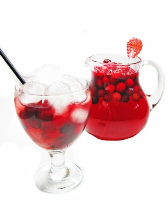 fruit cruchon cocktail punch in jug and wineglass with ice  photo