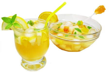 fruit cruchon cocktail punch in bowl and glass with ice and fruit photo