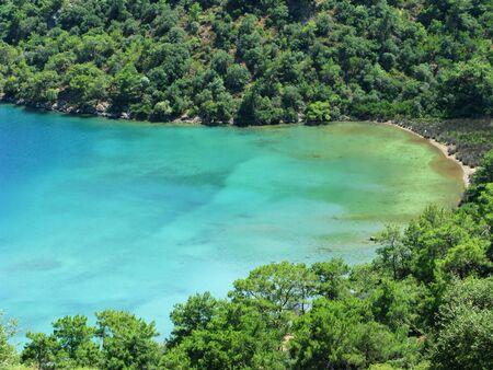 oludeniz: bay sea landscape view of beach and forest turkey
