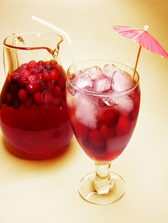 fruit cherry cocktail punch in jugwith ice and fruit