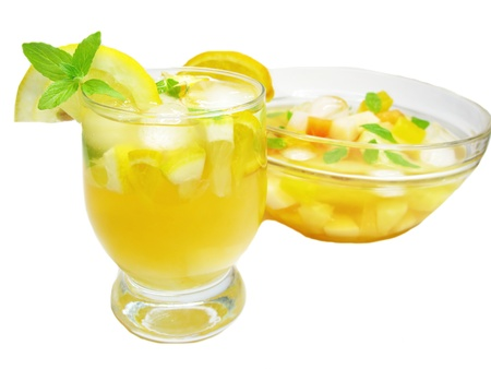 fruit cruchon cocktail punch in bowl and glass with ice  photo