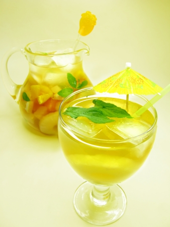 cruchon: fruit cruchon cocktail punch in jug and glass with ice and pineapple