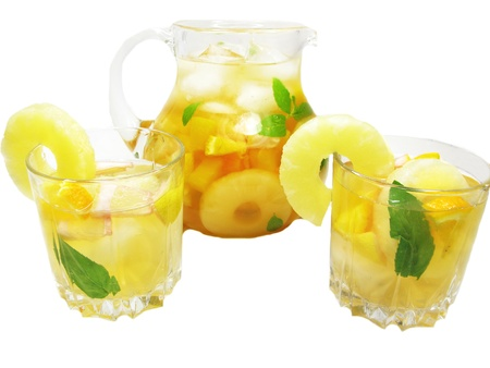 cruchon: fruit cruchon cocktail punch in bowl with ice and pineapple Stock Photo