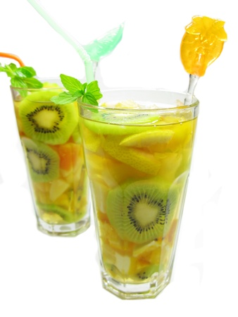 fruit punch cocktail drink with kiwi lemon and ice photo