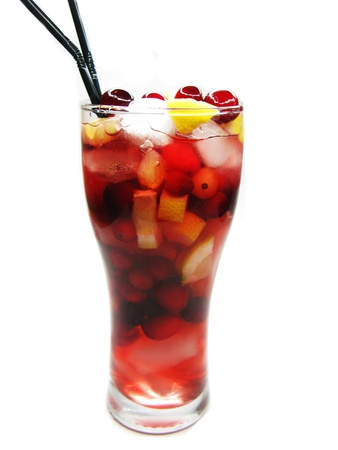 fruit cruchon cocktail punch in glass with ice and fruit photo