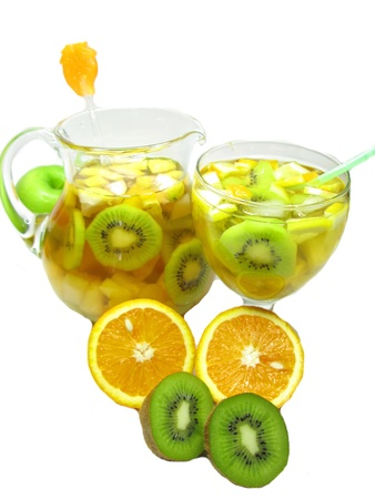 cruchon: fruit cruchon cocktail punch in jug and glass with ice and fruit Stock Photo