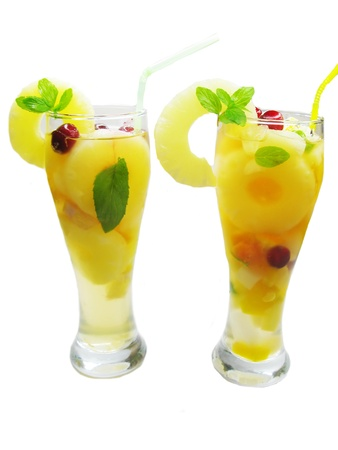 cruchon: fruit cruchon cocktail punch in glasses with ice and fruit Stock Photo