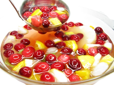 cruchon: fruit cruchon cocktail punch in bowl with ice and fruit Stock Photo