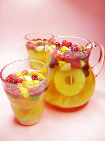 cruchon: fruit cruchon cocktail punch in jug and two glasses with ice and fruit Stock Photo