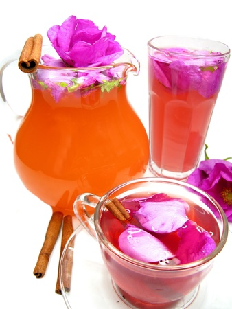 rose punch tea cocktail punch in jug and cup with ciinamon photo
