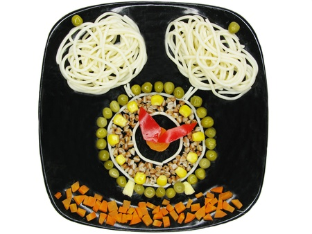 creative pasta porridge garnish with sausage clock shape photo