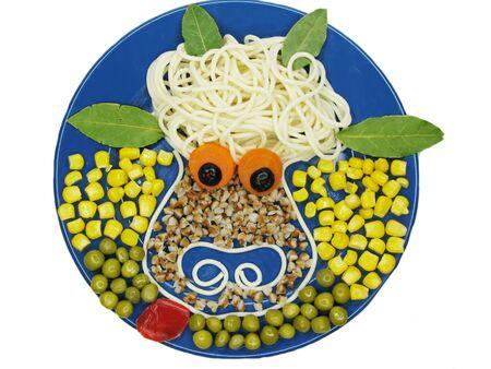 cow pea: creative millet porridge garnish with vegetables cow shape Stock Photo
