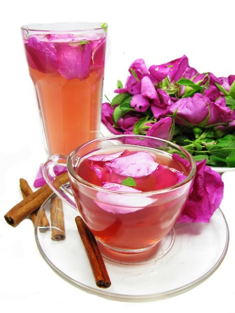 rose punch tea cocktail punch in jug and cup with cinnamon photo